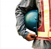 Construction man holding hat to his side