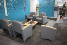 Reception room with Cordelle arm chairs and sofa